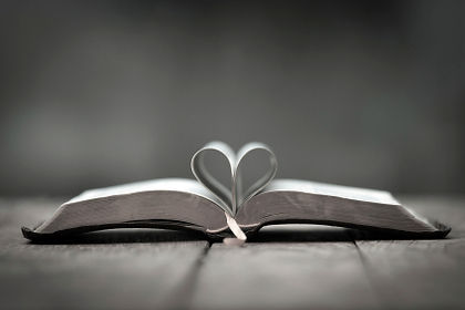 bible and heart shaped pages