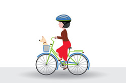 Lady riding her bike with her dog