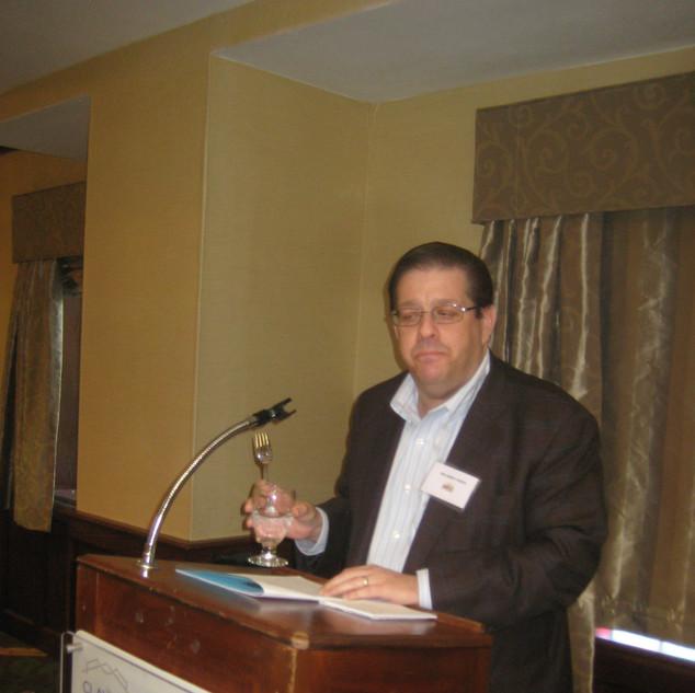 Orando J. Perez introducing Dr. Raven -