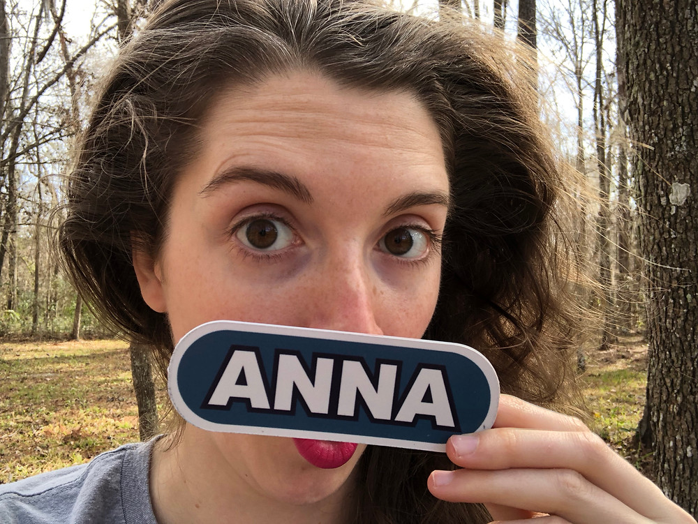 Anna holds her Wheel name plate to face