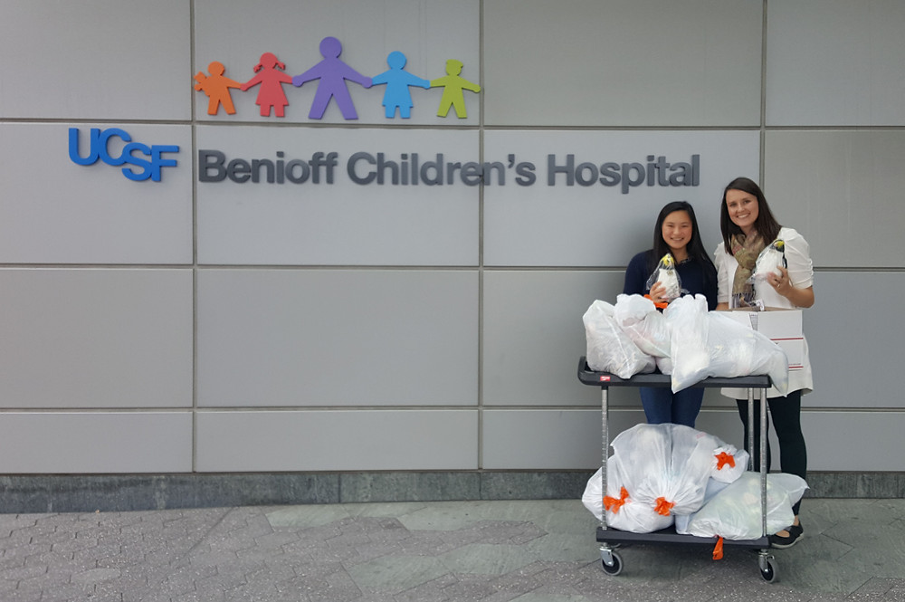 Chris Wong (Left) and Amanda McGee (Right) with the donations for the UCSF Benioff Children's Hospital