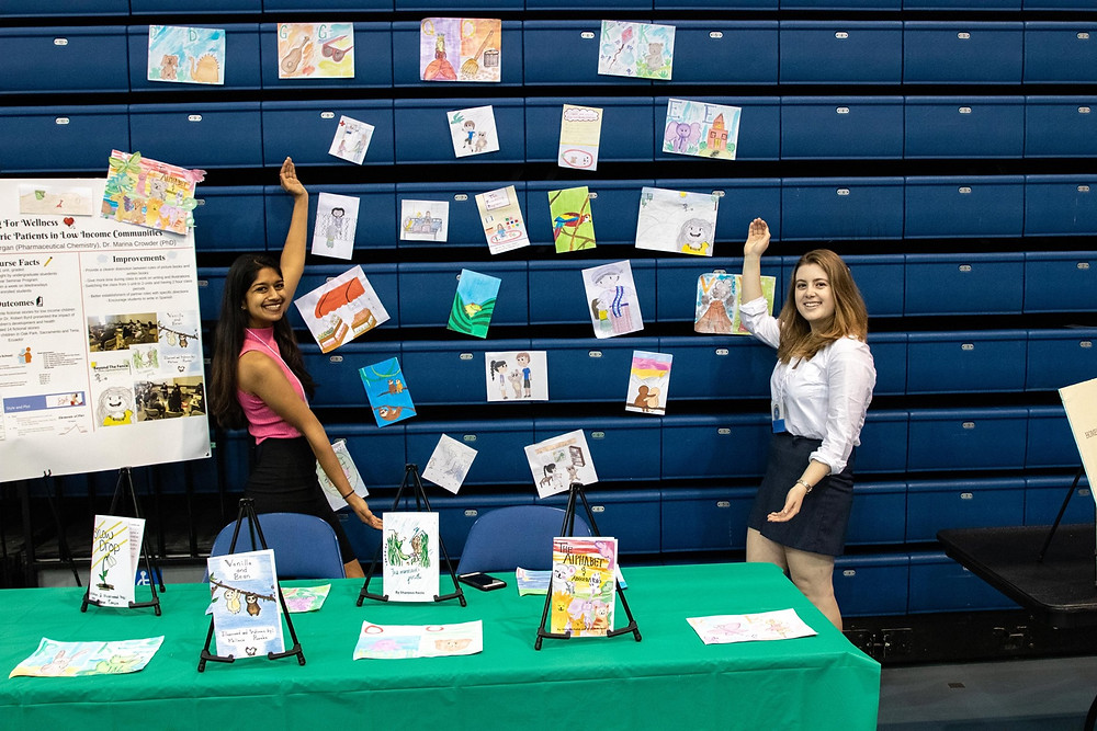 Riya Bansal (left) and Paige Morgan (right) pose in front of their booth at the UC Davis Undergraduate Research Project on April 26th, 2019.