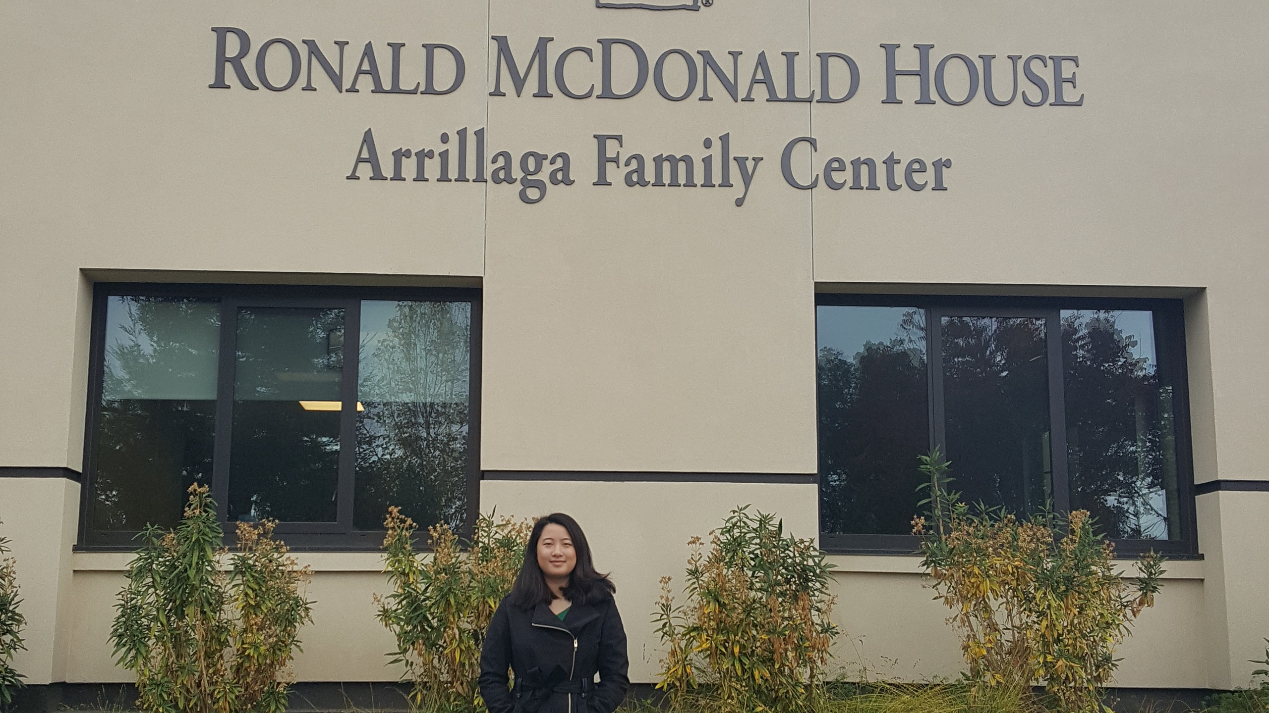Alexandra Wong in front of the Ronald McDonald House