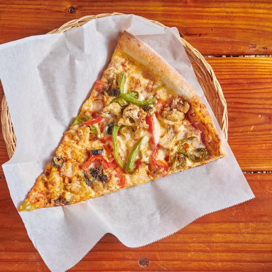 Seasonal Veggie Pizza Slice