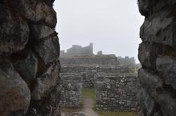View of Inca stone walls seen through Inca stone doorway