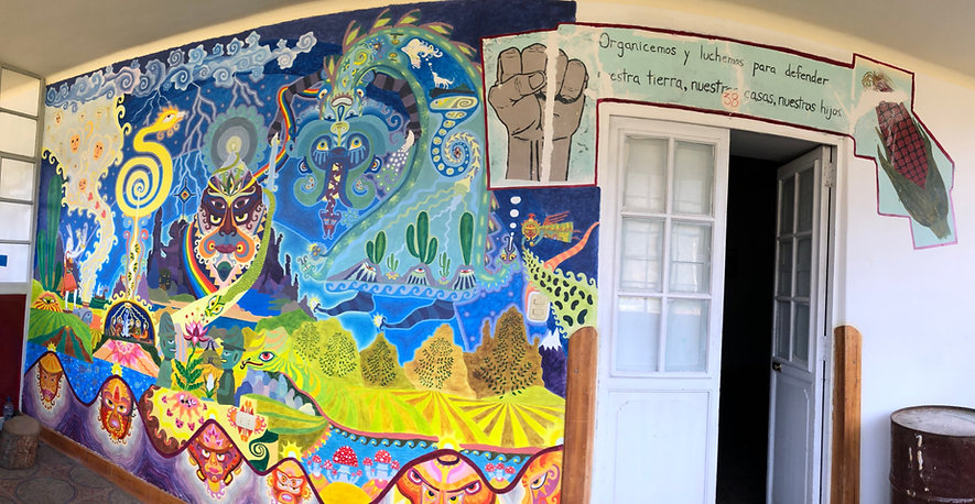 Photograph of a mural in Hualcayan, Cusco, Peru. Includes Andean mythological figures.