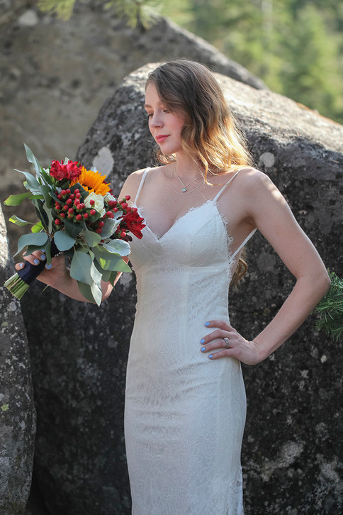 Beautiful bride in the dramatic boulder landscape of Lake Tahoe