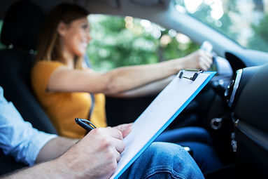close-up-view-of-driving-instructor-hold