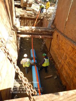 Crew Installing PVC in Casing