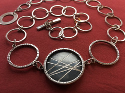 Engraved Silver Pendant with Large Rings