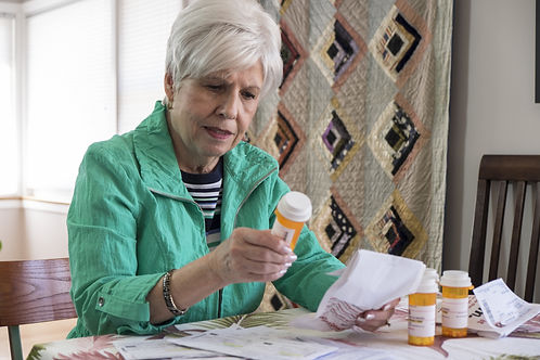 Senior woman with medication, reviewing