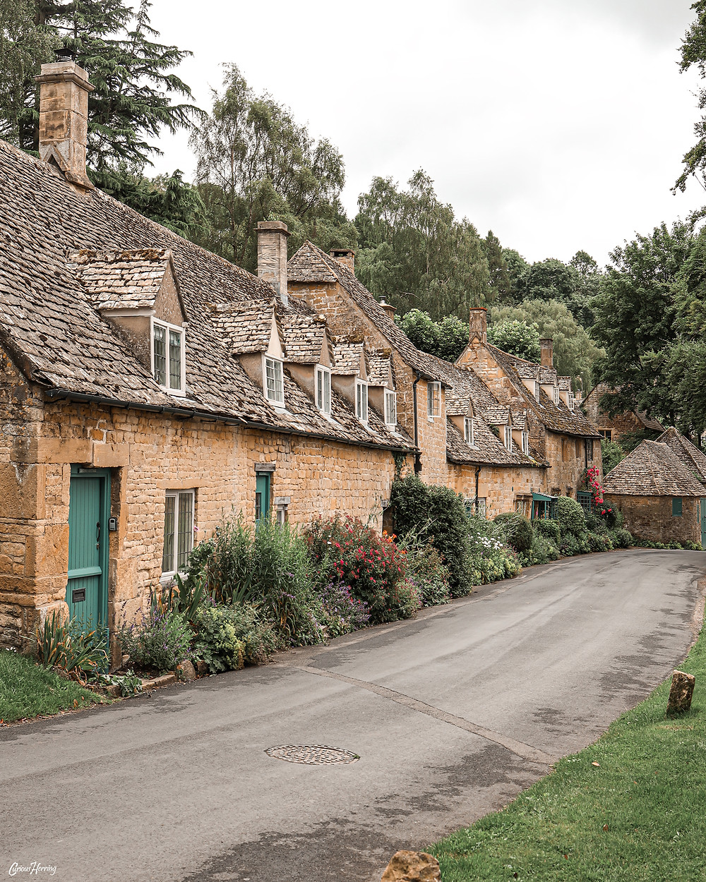 One of Britain's quietest villages, a row of ancient cottages in Snowshill, Cotswolds.