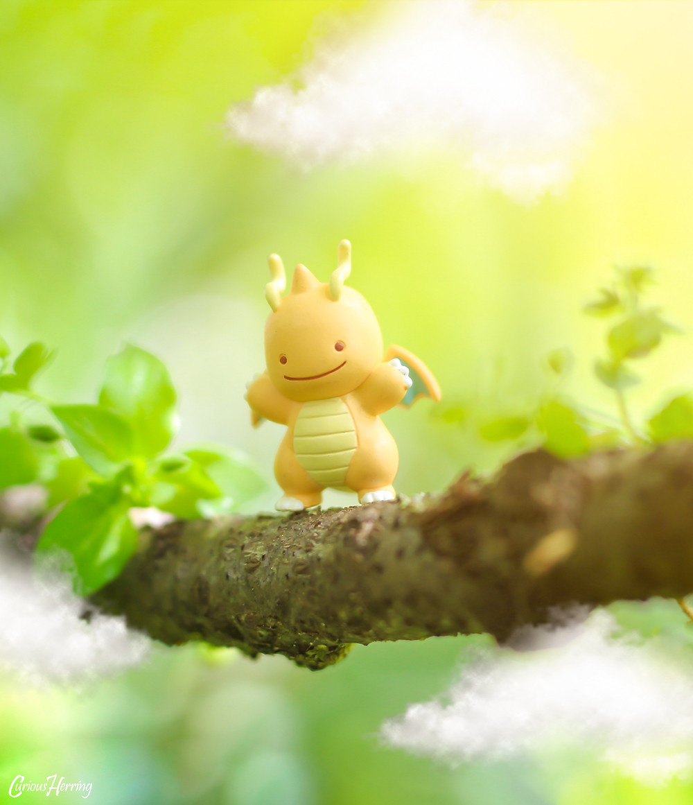 Toy Photography by CuriousHerring of a Ditto Dragonite from Pokemon. Ditto stands on the treetops ready to learn to fly.