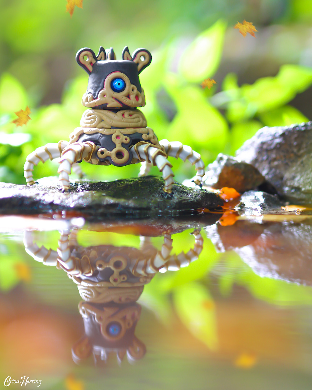 Toy photography by CuriousHerring of Guardian Nendoroid from Nintendo Zelda, Breath of the Wild. A guardian sits at the edge of the lake, watching the world go by.