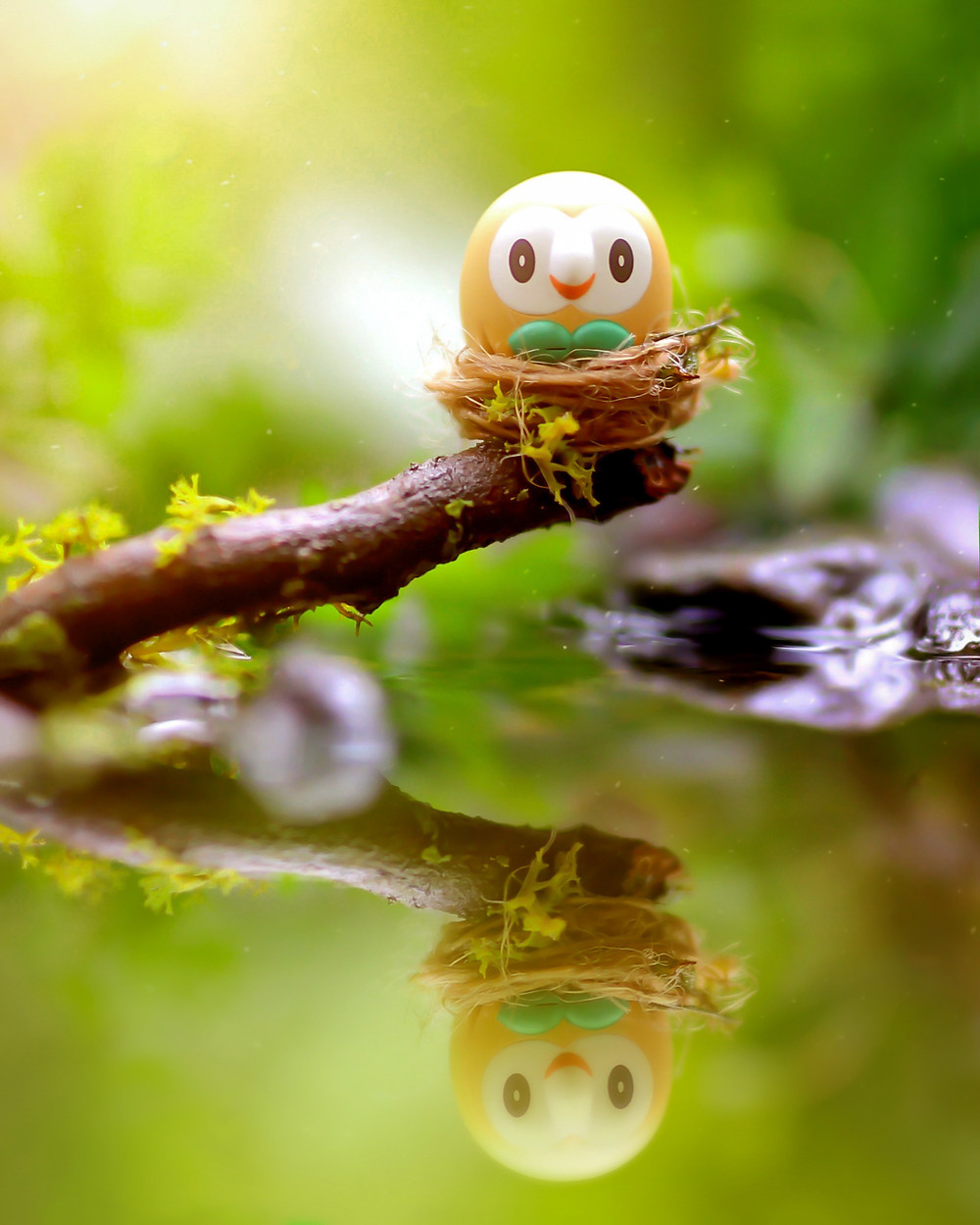 Toy Photography by CuriousHerring of Rowlet Pokemon from the Selene (Mizuki) Figma made by the Good Smile Company. Rowlet sits in a nest on top of the swamp waters of the forest.