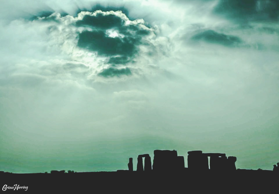 Stone Henge in the Costwolds, United Kingdom. Landsacpe Photography taken at Stone Henge with thick clouds and Silhouetted landmark in the United Kingdom.