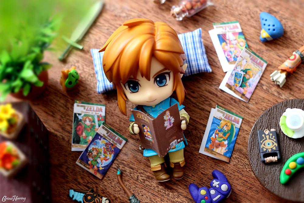 Toy Photography of Breath of the Wild Link Nendoroid Toy Photofraphy reading miniature paper craft Zelda Manga books