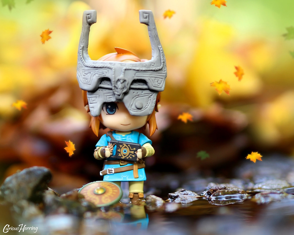 BotW Legend of Zelda Nendoroid Link Nendoroid and toy photography featuring link by the waterside wearing Midna's helmet with Sheikah Slate.