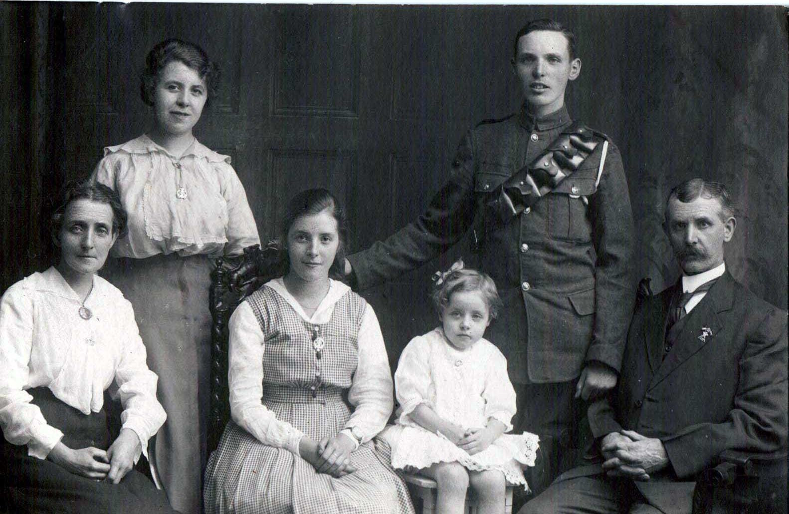 Gunner, father wears 11th Hussars badge.