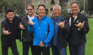 Five Hawaiians present hang-loose gesture