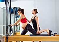pregnant woman pilates reformer cadillac