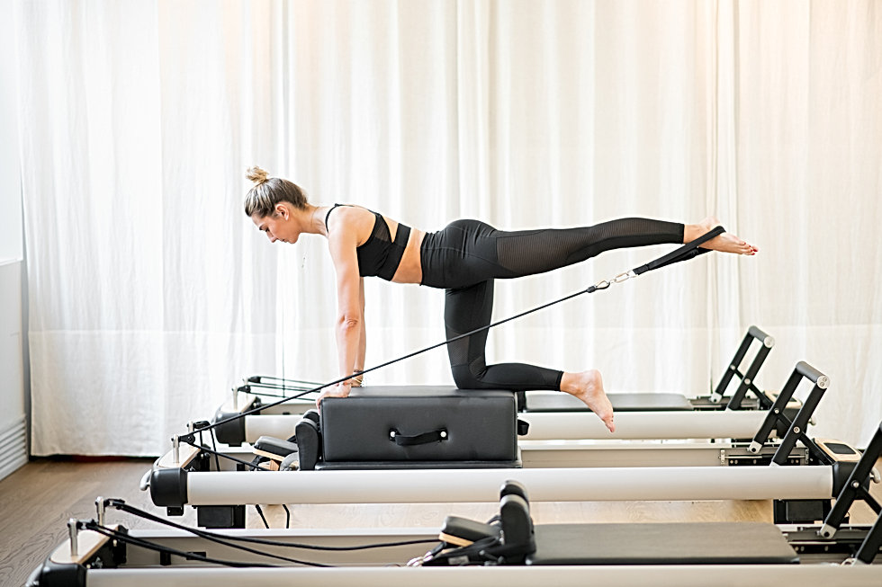 Woman performing a pilates diagonal stab