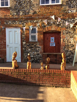 Stall set up of chainsaw carvings