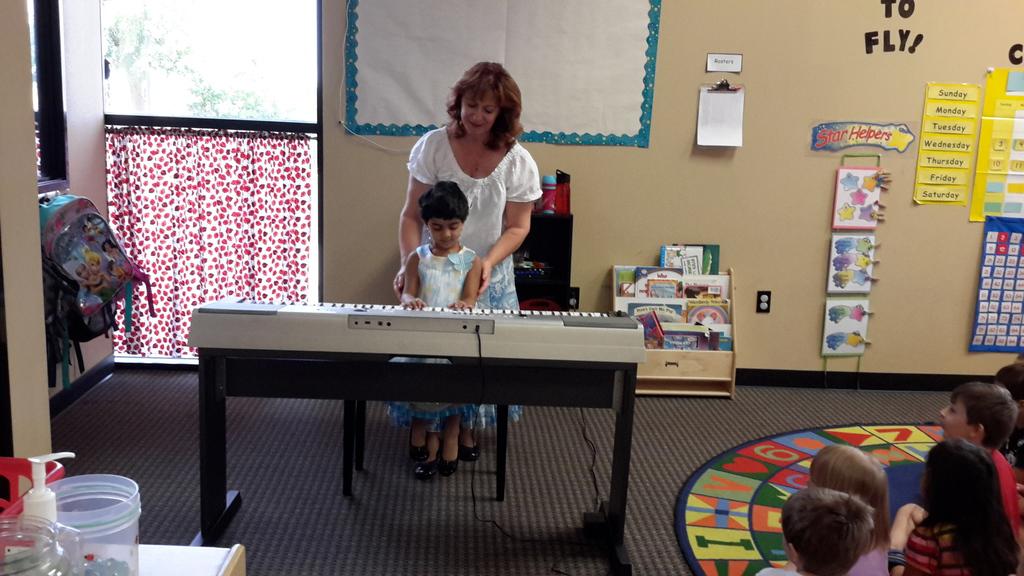Young Composer Ambassador's Club at the piano