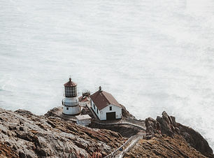 Lighthouse by the Ocean