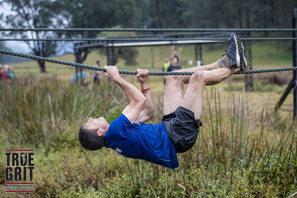 Personal trainer Ash Radford moving along a rope