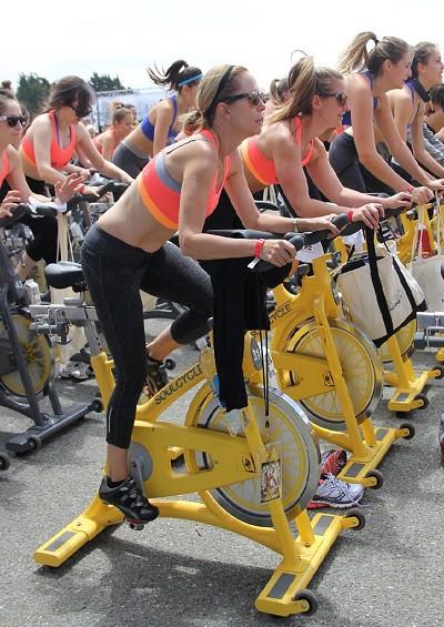 Ladies riding exercise bike