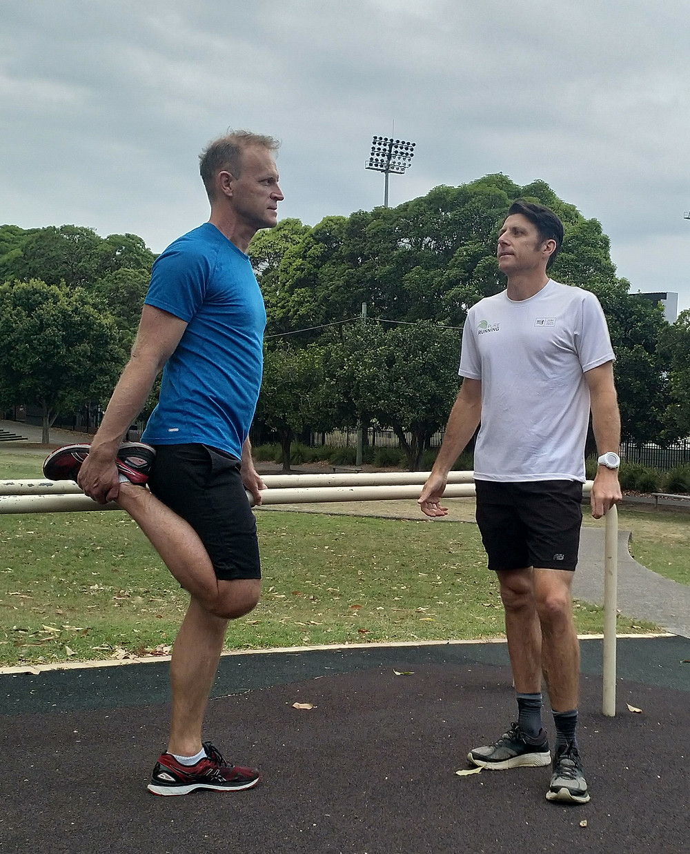 Mobile personal trainer instructing client in a park