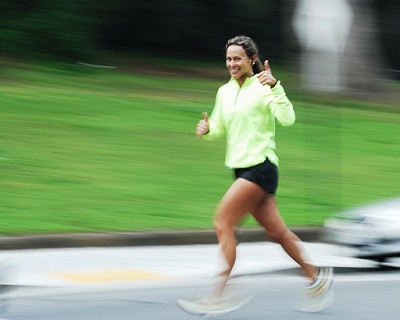 Smiling lady running, happy with return on investment from exercise ment