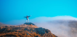 outstretched-small-person-on-mountain