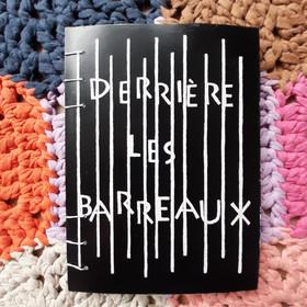 DERRIÈRE LES BARREAUX