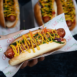 Gourmet hot dog with a range of toppings.