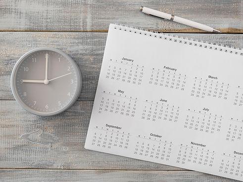 flat-lay-desk-calendar-analog-clock.jpg