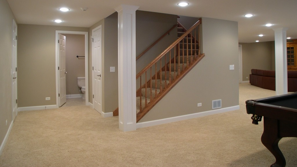 Picturesque-Finished-Basement-Idea-with-Gray-Wall-Paint-Color-and-White-Pillars-and-Cream-Carpet-als