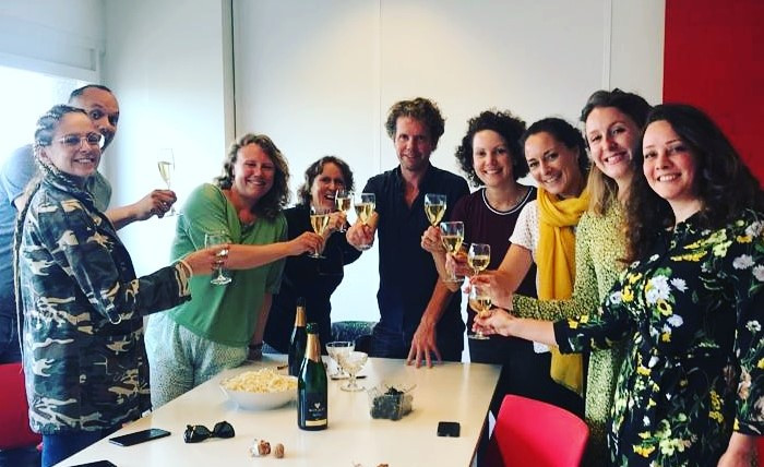 The teams of 'Wat We Doen' and NewBees toast to our collaboration and EU support.