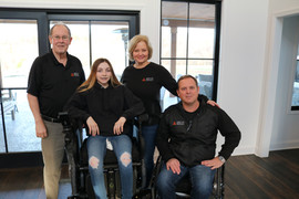 Founders, Bob Hyde, Mari and Gary Linfoot and Emily the first day Emily got to try the iBOT.