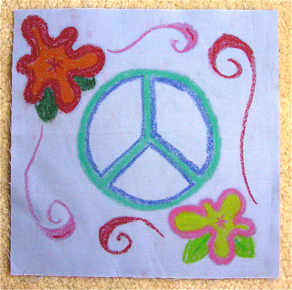 A drawing of blue and teal peace sign with red swirls and red, green and orange flowers and leaves surrounding it