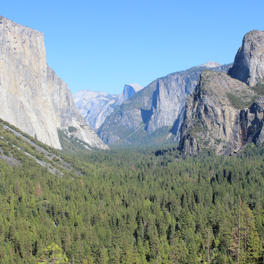 This is a view of the valley floor at Yosemite with El Capitan in the foreground and Half Dome in the far background.