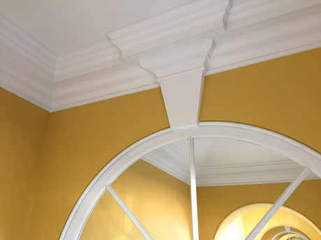 Fibrous archway and cornice