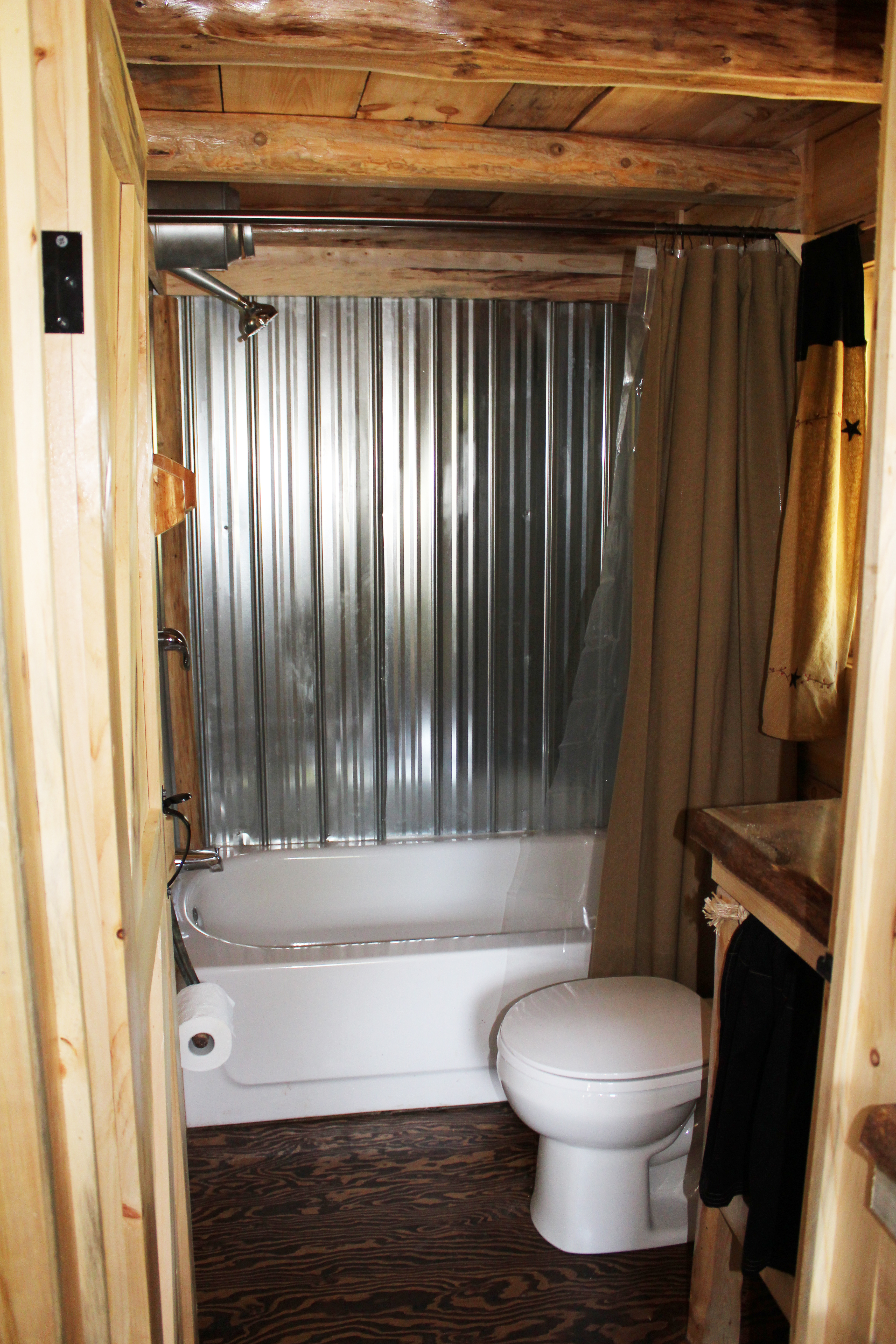 Full size tub/shower bathroom.