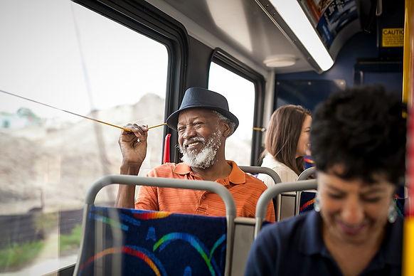 Older African American man riding a CapMetro bus