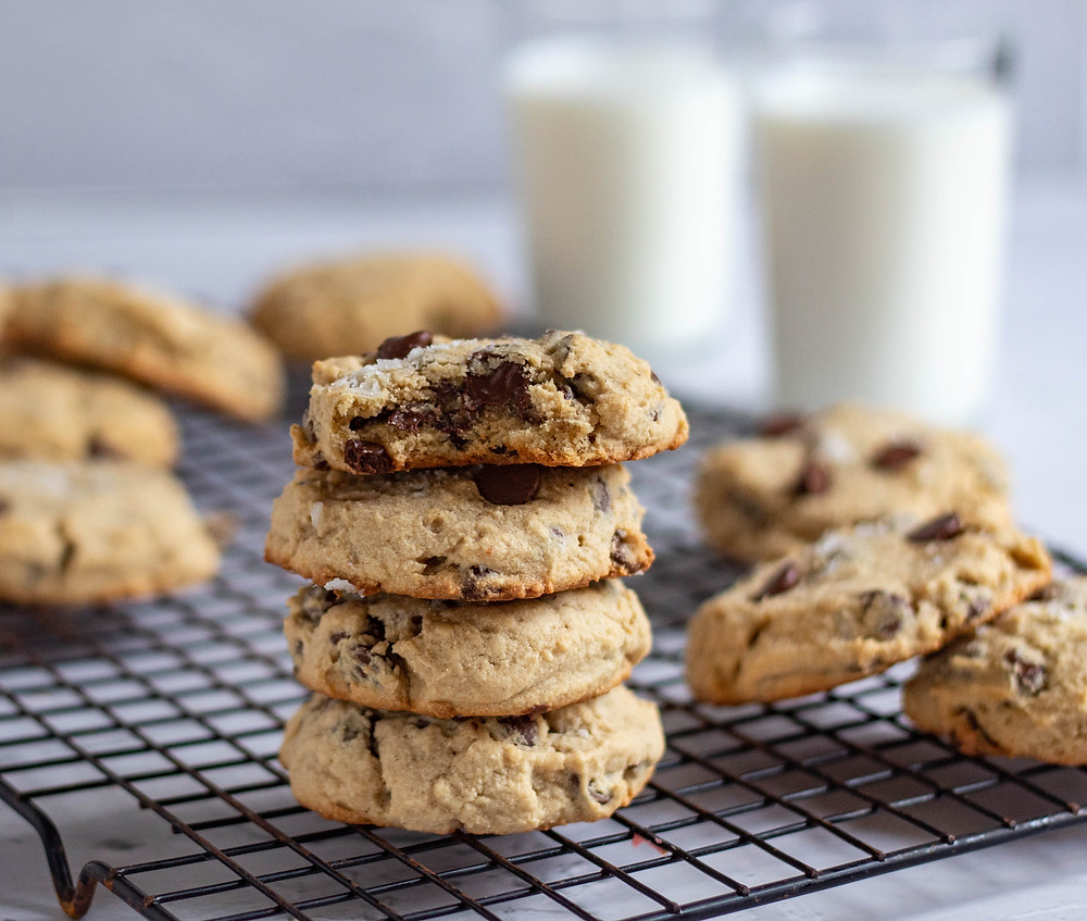 Stack of cookies with a bite taken out of one.