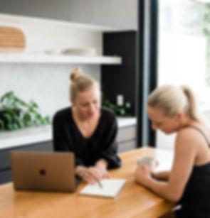 Follow Up Consultation Alex Joy advises a client on a laptop