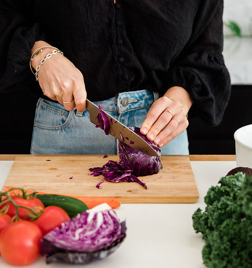 Woman slices vegetables