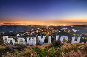 looking at the back of the hollywood sign looking over los angeles at sunset. consilium events.