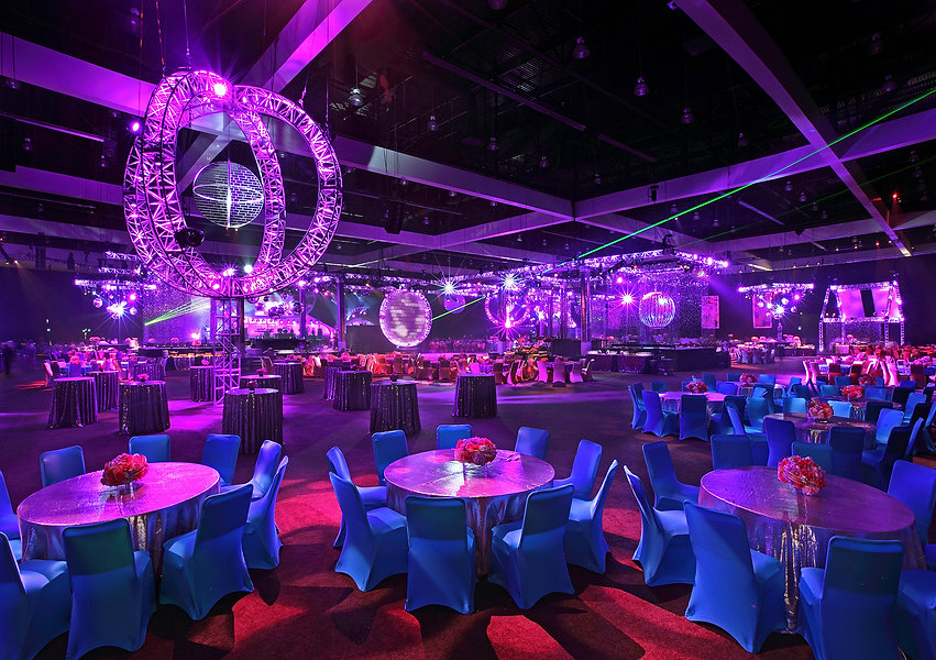 a large room set for a party with purple furniture and lights. consilium experiential marketing agency.